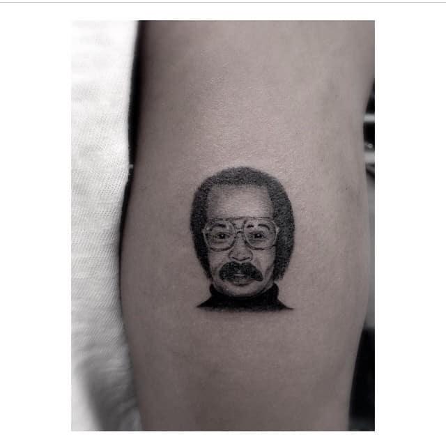 drake father's mugshot tattoo