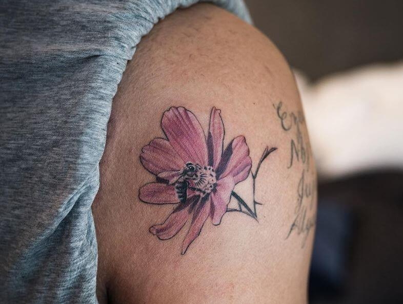 drake flower and bee tattoo