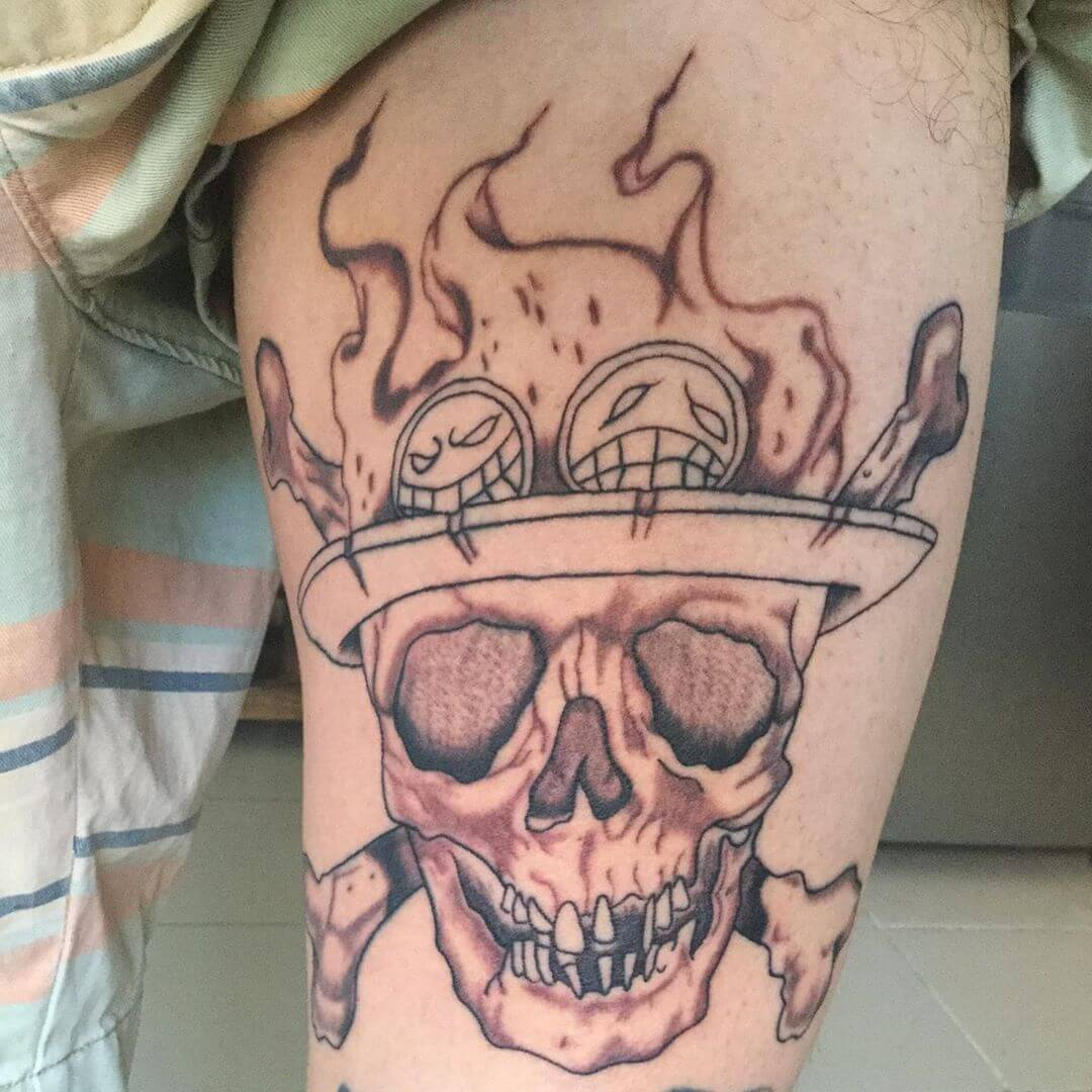one piece skull tattoo on thigh