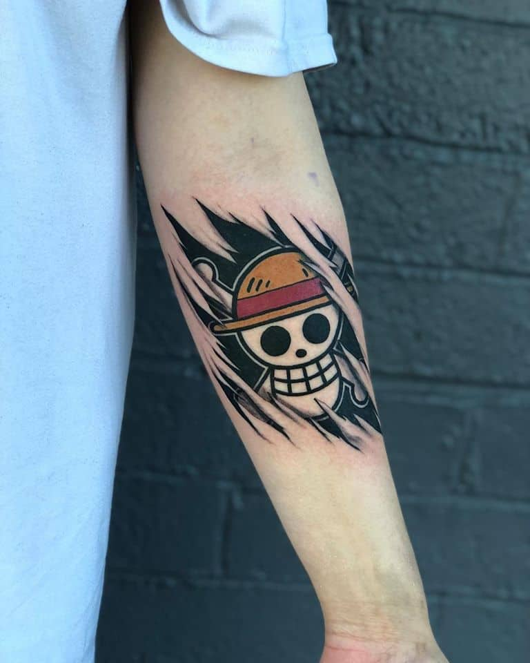 one piece skull arm tattoo