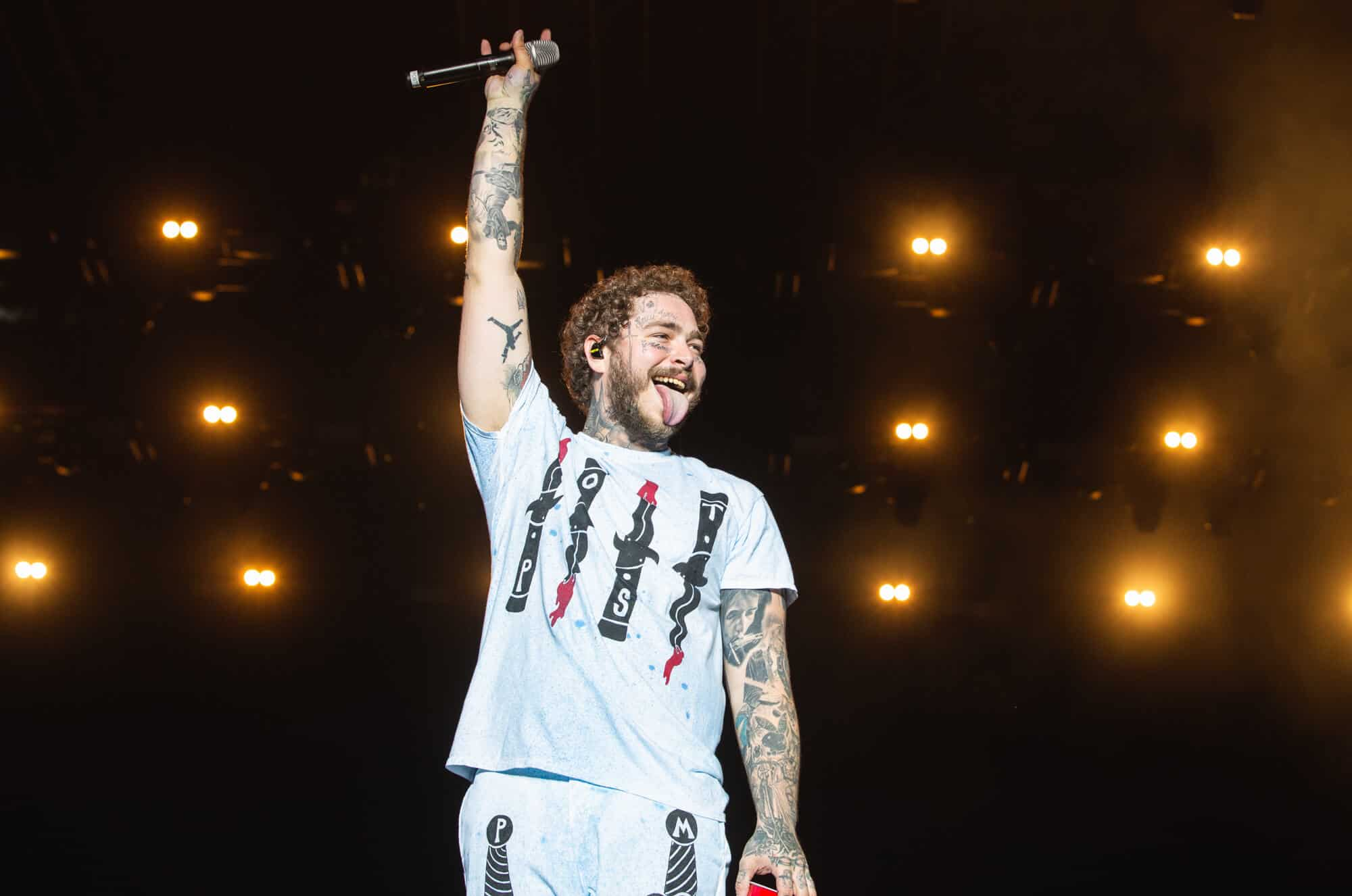post malone gallenson's gun logo tattoo