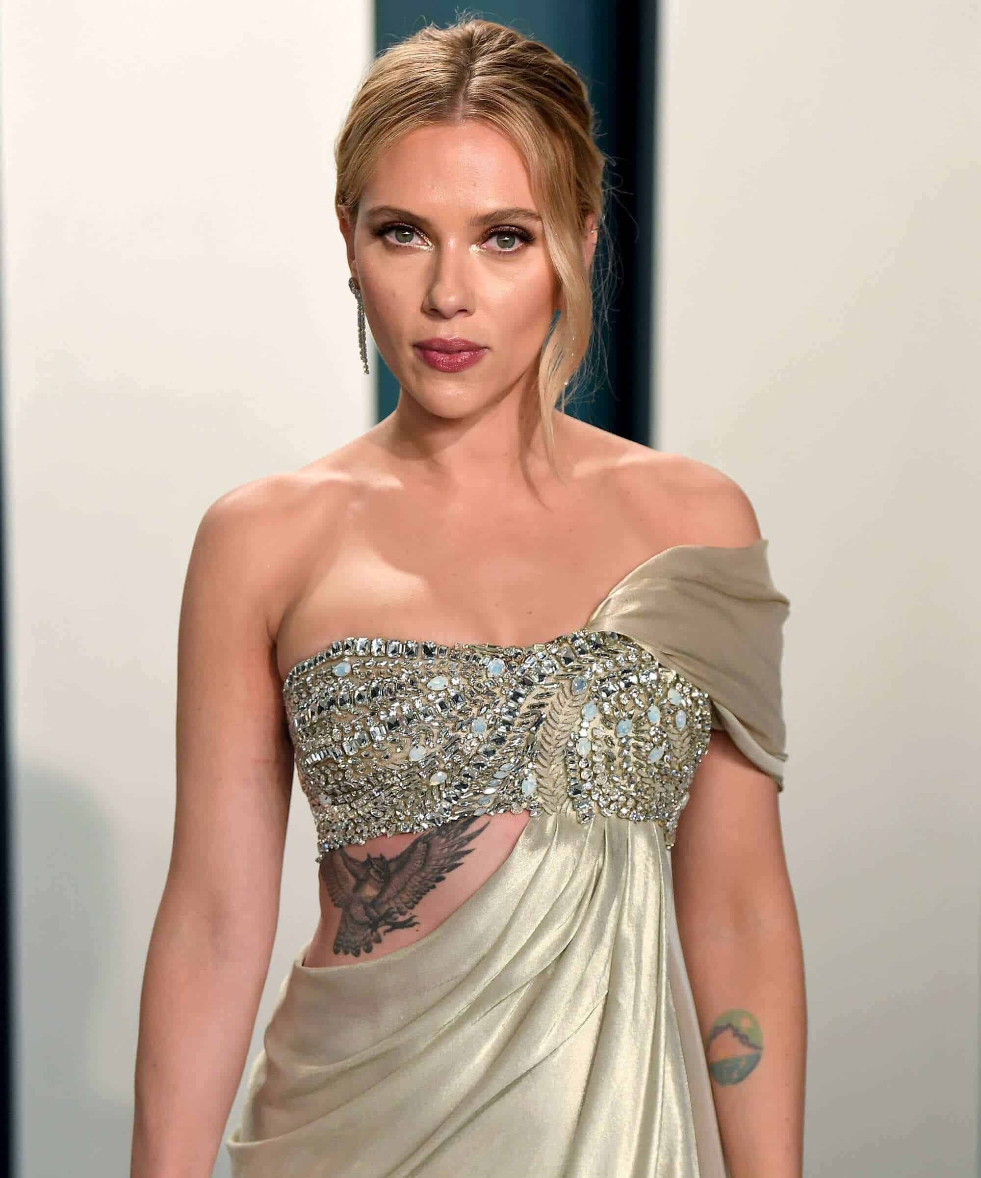scarlett johansson flying owl tattoo