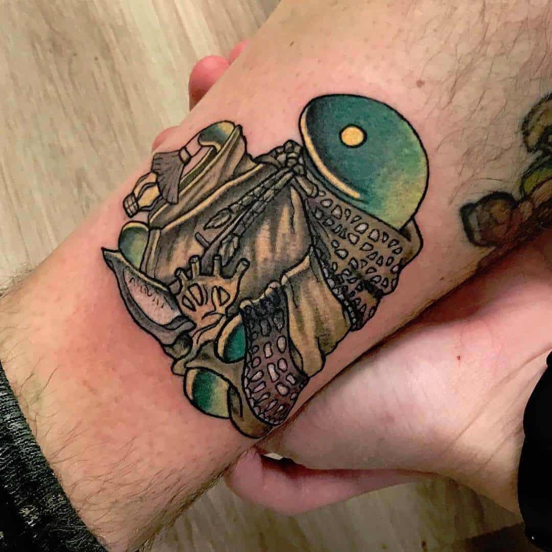 tonberry tattoo on leg