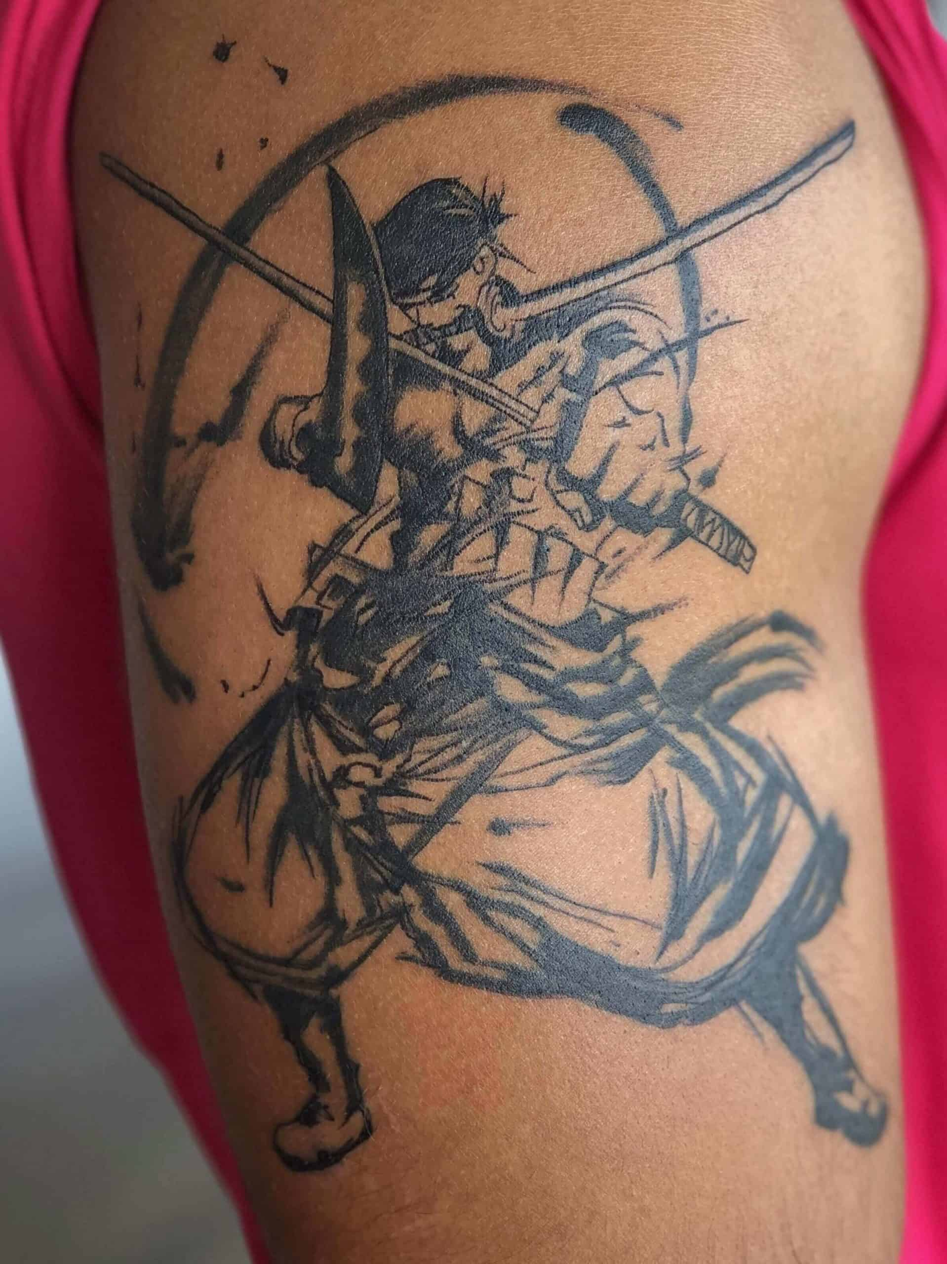 zoro tattoo on arm