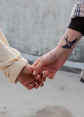 2 women holding hands