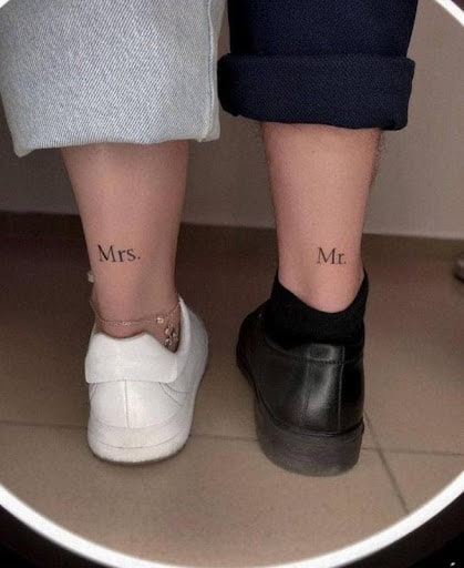A couple with tattoos on back of legs_